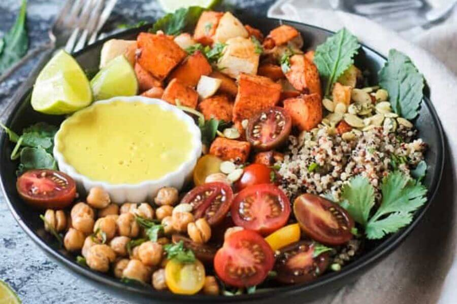 SWEET POTATO QUINOA BOWL W/ CASHEW CURRY SAUCE
